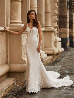 Special Order - Allow 4-6 months. This fit and flare gown features beaded lace, sparkle tulle, and a deep v-neckline and is sampled in a bridal size 18, in the color pictured. Available to order in sizes 2-28, in ivory/latte, or all ivory.