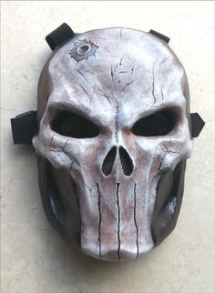 Punisher SKull Mask... Premium Edition: It dont get any better than this!  Back by popular Demand !   What you see is what you get!  Features: - Wearable Mask for adult heads up to 17.5cm OR 6.9 inches forehead Width - 3 layered Fiberglass Resin - Battle Damaged Design - Ray Band Tinted Lenses - Metal mesh nose cover - High quality Elastic straps - 1cm thick EVA Foam padded interior for added comfort + protection.  * Back plate IS INCLUDED  ** Not recommended for Airsoft or Paintball…