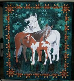 Beauty of the Beast is a fiber art work showing a family of horses the father standing strong the mother leaning to protect her baby and a colt as cute as can be beside them. this was a juried finalist in the Houston International Quilt Show in 2013 Western Quilts, Barn Quilts, Quilting Projects, Sewing Projects, Quilting Ideas, Horse Quilt, Animal Quilts, Patches, Applique Quilts