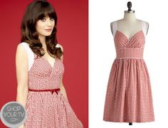 Jess Day (Zooey Deschanel) wears this red printed patterned dress in the promo picture for Season 3 of New Girl. It is theModcloth Paradise Tile Dress. Buy it HERE