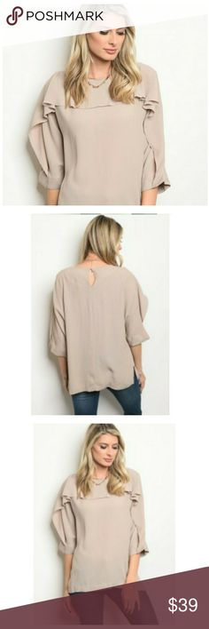 """Taupe Top Elegant, feminine, and stylish taupe top. Mid / 3/4 Length sleeve. Ruffled neckline and sleeve with key hole back.   Sizes: S, M, L   MEASUREMENTS - available later   Length: 26""""   Material: 58% viscose, 42% polyester  Brand New, Excellent condition   Fall fashion, Thanksgiving, thankful, grateful, holiday, ruffles Tops"""