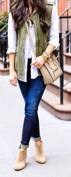 olive vest with skinny jeans and tan booties