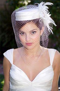 Definitely my favorite...Google Image Result for http://weddingbellsblog.com/wp-content/uploads/2009/09/pillbox-hat.jpg