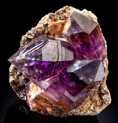 Amethyst crystals clustered atop matrix. Source: Erongo Region, Namibia.