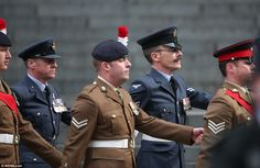 Marching into the cathedral for the service are members of the Armed Forces, who gather to...