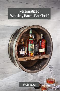 Ideal for whiskey lovers, this reclaimed whiskey barrel bar shelf can be personalized with a family name and year.