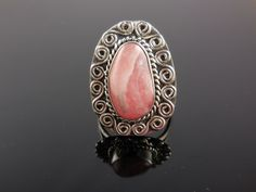 Made 10x17mm rhodochrosite cabochon gemstone, sterling silver wire and metal. Size 8.5