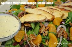 Spinach Mandarin Orange & Pecan Salad-       1 12oz bag of baby spinach  (washed and dried)      1 cup crasins (dried cranberries)      1/8-1/4 cup red onion sliced thin      3/4 cup candied pecans      2 cups mandarin oranges    Top with grilled chicken (Cilantro Lime Marinade for Chicken) and Mandarin Orange Lime Poppy Sees Dressing