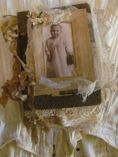 Altered book with old photo and laces.