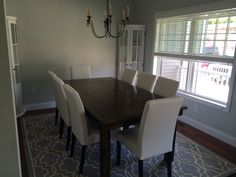Our dining room - James & James farmhouse table Pier 1 Dana Parson chairs Ballard curved cabinets Joss & Main rug ...still need curtains and art