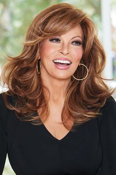 """Curve Appeal by Raquel Welch Wigs - Fiery Copper or Rusty Auburn  $212  """"This heat friendly synthetic wig can be easily styled curly or straight with natural movement and versatility. The lace front hairline gives you natural off-the-face styling with a monofilament part allows you to direct the side swept bang any way you choose."""""""
