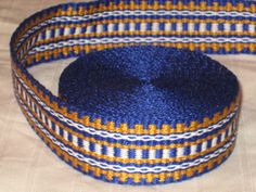Simple, but effective plain-weave pattern on this inkle band. Woven by Anna Bjugstad, a.k.a. applegirl5 on Etsy.com.