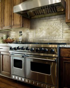 #Retroclassique features four #earthy #tones of #Avocado, #Mocha, #Pewter & #Silver have a #natural slight #variation of #hue. These #tiles are crafted using a fumé technique that gives each #tile a #unique #pattern and #color variation. Pictured here: a #kitchen #RoomScene featuring Retroclassique Avocado #3x6 and #CirclesListello from #MidAmericaTile.