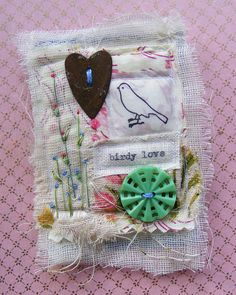 textile and collage brooch