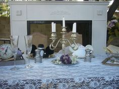 Purple and silver wedding table with lace tablecloth.
