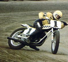 Kenny Roberts. First American to win a Grand Prix motorcycle racing world championship.  Three-time Grand Prix world champion (1978, 1979, 1980). Two-time winner of the A.M.A. Grand National Championship. One of only four riders in AMA racing history to win the AMA Grand Slam, representing Grand National wins at a mile, half-mile, short-track, TT Steeplechase and road race events.