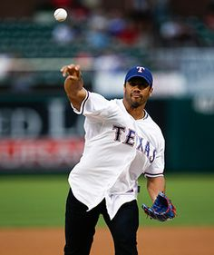 Russell Wilson throws the first pitch of a Texas Rangers game.