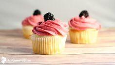 Lemon Cupcakes topped with a blackberry buttercream. From TheGraciousWife.com #lemon #cupcakes #recipe #buttercream