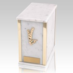 The Designer Bianco Carrera Marble Cremation Urn is assembled from real natural quarried stone. The urn has 24k gold plated decoration option and the bottom has felt to protect the surface were the urn rests. This wonderful natural stone urn will create a dignified resting place for eternity to come. Memorial Urns, Funeral Memorial, Cremation Urns, Cremation Jewelry, Ing, Casket, Carrera, Natural Stones, Decorative Plates