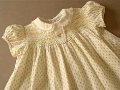 Vintage baby dress 1960's-70's pale yellow rosebud print cotton, smocked, lace edged, button closure, 12-18mo. by Nannette, darling.