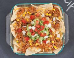 Mexicali Pork Nachos | Mexicali Pork Nachos Recipe - Pulled pork takes center stage in this extra cheesy loaded Southern-style nacho recipe. #Schwans #EasyRecipes #Inspiration