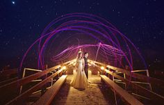 photo by Los Angeles based wedding photographer Jeff Newsom - bride and groom encircled in light