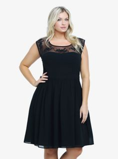 Floral Embroidered Mesh Illusion Dress......A sheer mesh yoke with embroidered flowers and sequin accents lends a delicate texture to this sleeveless chiffon LBD. A keyhole adds a sexy detail to the back. Fully lined.