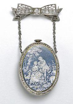 A LADY'S PLATINUM DIAMOND SET ENAMEL BROOCH WATCH CIRCA 1920