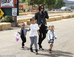 Monochromes: Kourtney took Penelope and Mason with their cousin, all co-ordinated in black...