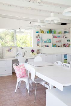 So clean, simple.  Love the colourful stuff on white shelves.