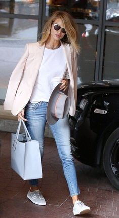 Rosy with Airport Style in a blush blazer, white t-shirt and denim. See more at www.HerFashionedLife.com