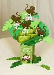 centerpiece - gift bag with tissue paper, cut out tropical leaves and little monkeys #PampersPinParty