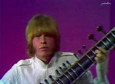 Brian was a vision in white on his own platform playing sitar for 'Paint It Black' on Ed Sullivan Show 1967. He looked into the camera a lot.