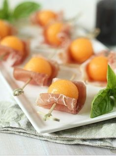 Prosciutto & Melon Balls on skewers. Such a great appetizer!