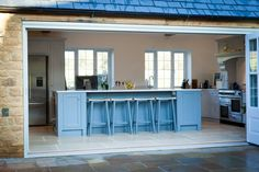 We always knew this was going look great. I love this island and the large doors opening to the garden! The opening frames the island beautifully. #kitchenisland #bifoldingdoors #gardenroom