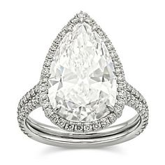 Fashioned in platinum, this luxurious pear shape diamond weighs 5.04ct and is framed by 119 round diamonds weighing a total of 0.79cttw.  Center diamond is D/VS2 and is accompanied by a GIA diamond report.