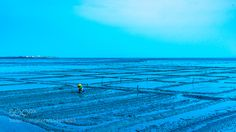 Lady working at mudflats by Priapus via http://ift.tt/25980PR