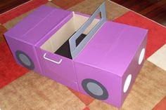 Car made out of cardboard boxes with moving steering wheel