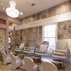 Southern Swings Nail Bar is the just what you need to pamper the bride-to-be. Sweet tea and even sweeter massages make this spot well-known for their mani-pedis. That and the fact that each of their pedicure stations are PORCH SWINGS! They even offer pedicures on their outside porch, also in porch swings. Did we mention mimosas are also available? Get your sassy southern drawl ready, girls! Highlights: Pricing: $25+ per person Capacity: Up to 50 people What's Included: - Professional manicure, p Beauty Bar Salon, Beauty Salon Design, Salon And Spa, Beauty Salons, Nail Salon Design, Nail Salon Decor, Spa Interior Design, Spa Design, Beauty Salon Interior