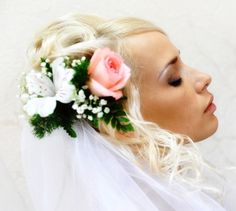 Bride's wedding hair style updo with flowers & veil Keywords: #hairstyles #weddinghair #weddinghairstyles #updo #weddingupdo #weddings #weddingplanning #jevel #jevelwedding #jevelweddingplanning Follow Us: www.jevelweddingplanning.com www.facebook.com/jevelweddingplanning/  www.pinterest.com/jevelwedding/ www.linkedin.com/in/jevel/ www.twitter.com/jevelwedding/ https://plus.google.com/u/0/105109573846210973606/