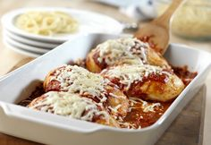 Chicken is topped with Prego® Traditional Italian Sauce, mozzarella and Parmesan cheeses, baked to tenderness and served over spaghetti.