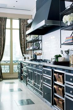 La Cornue range, hood, and cabinets w/ nickel-silver counter; Jessica Lagrange Interiors