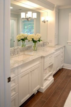 If you're considering selling your house, it's best to keep its design minimal. Stick to neutral colors, and good-quality white goods with classical lines.  [French Country Bathroom Ideas, French Country Bathroom Vanity, Double Vanity Bathroom, Built In Shelves, Bathroom Ideas, Bathroom Design Ideas, Marble Bathroom Countertop, Large Mirror]