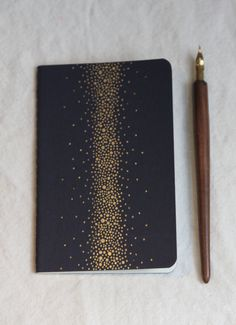 Galaxy Notebook - Black with Gold Stars ~ $14.00 by TheInfiniteThread on Etsy