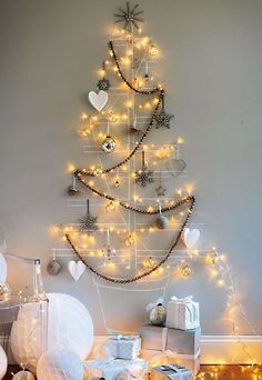 40 DIY Alternative Christmas Trees Adding Fun Wall Decorations to Green Holiday Decor – Lushome Wall Christmas Tree, Creative Christmas Trees, Noel Christmas, Outdoor Christmas, Christmas Tree Decorations, Christmas Lights, White Christmas, Wall Decorations, Modern Christmas
