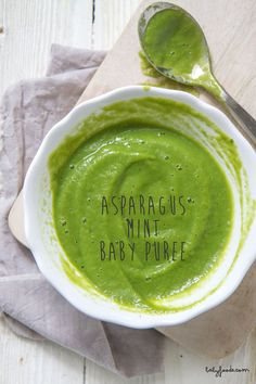 Ohhhhh SNAP! This green puree is going to rock your baby's world!I am not  even slightly kidding around here, asparagus puree is where it is at!  It's spring and that means asparagus is popping up all around the market,  so go ahead and grab a couple bunches and make this delicious puree for