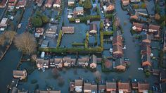 Houses in Blackett Close are inundated with flood water on Feb. 16, 2014, in Staines-Upon-Thames, England. Housing near the river Thames has suffered flooding after the river burst it's banks on Feb. 10, 2014.