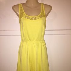 Yellow cute dress Size small with lace trim around neckline. Last pic is back of the dress. Pearl Dresses