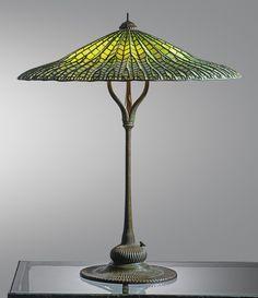 """Tiffany Studios  """"LOTUS"""" TABLE LAMP  shade impressed TIFFANY STUDIOS NEW YORK  base impressed TIFFANY STUDIOS/NEW YORK/374  leaded glass and patinated bronze  31 1/2  in. (80 cm) high  26 1/8  in. (66.4 cm) diameter of shade  circa 1910"""