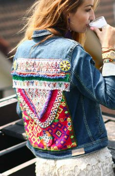 A boho hippie style vintage denim jacket with a handmade banjara patch